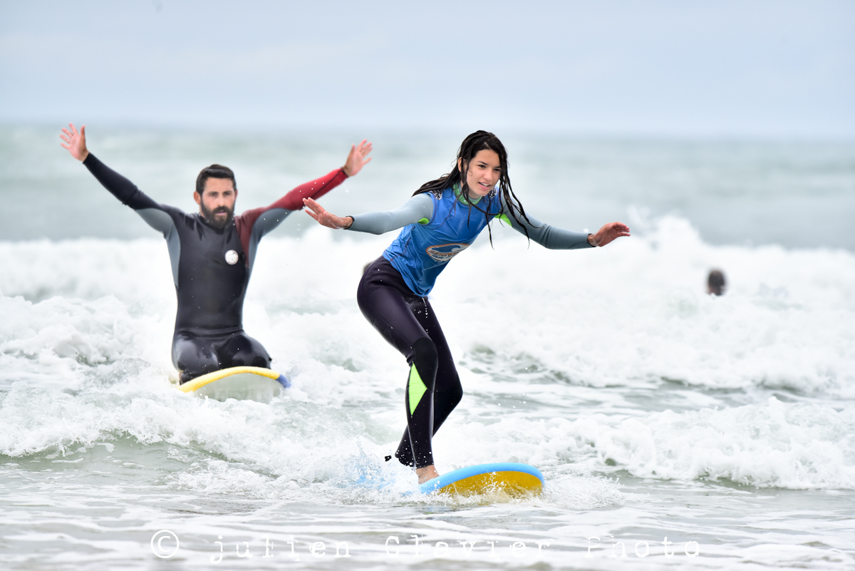 surfing lessons coach student