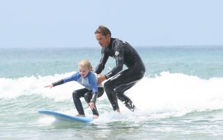 holding the kids surfing