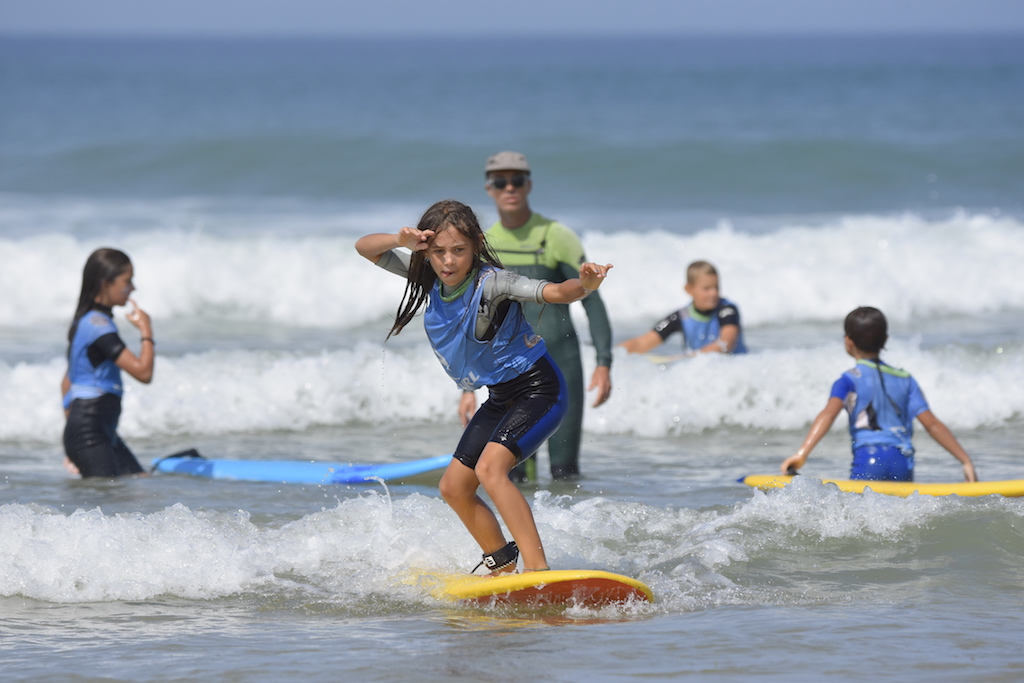 kids surfing perfect wave